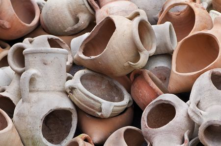 craftwork: Stack of different kind of decorative terracotta containers