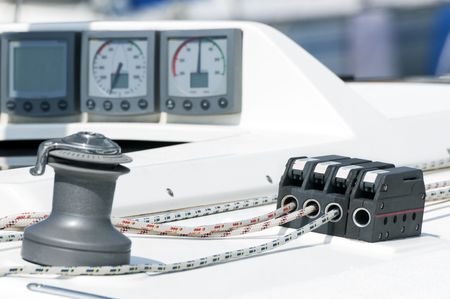 Close-up of a boat with navigation instruments, winch and rope stopper Stock Photo