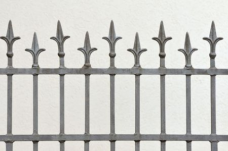 Wrought iron fence with decotative arrows