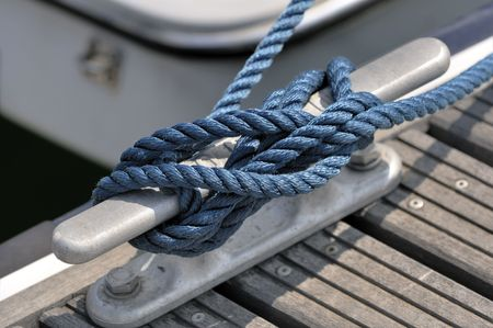 Close-up of a jetty bitt with tied up rope