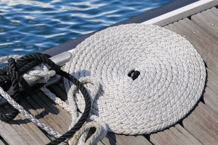 Bitt with coiled rope on a jetty