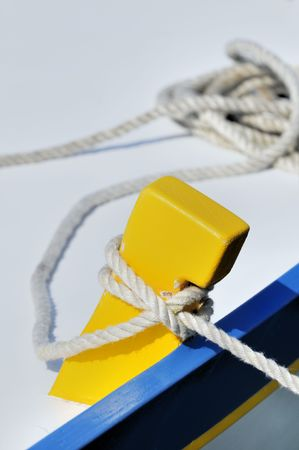 tiedup: Close-up of a tied-up rope securing boat to dock Stock Photo