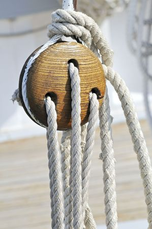 Close-up of a vintage boat: wooden block and ropes Stock Photo