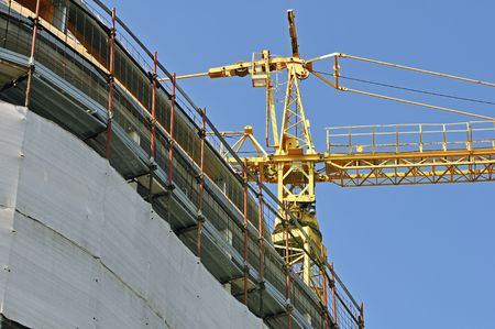 View of a new building with a yellow crane photo