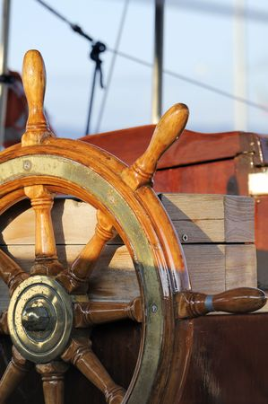 details: Detail of a wooden steering wheel on a vintage sailboat