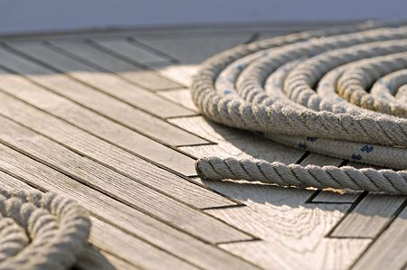 Close-up of rolled-up ropes on a boat deck