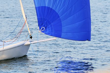 spinnaker: Detail of a boat bow with a blue spinnaker Stock Photo