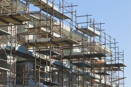erect: Building under construction with scaffolding Stock Photo