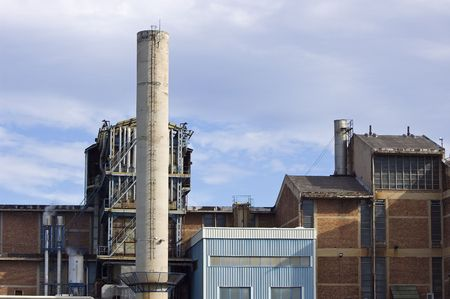 Detail of an industrial plant with a chimney