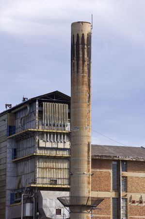 Detail of an industrial plant with chimney Stock Photo