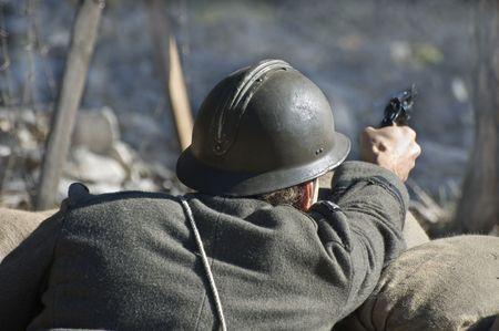 First World War soldier with gun shooting