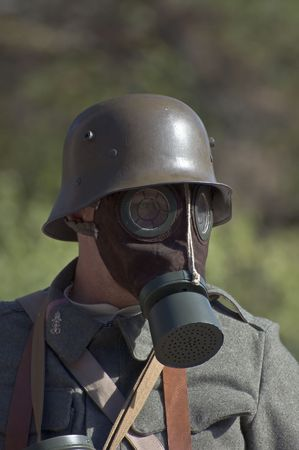 World war soldier with gas mask and helmet photo
