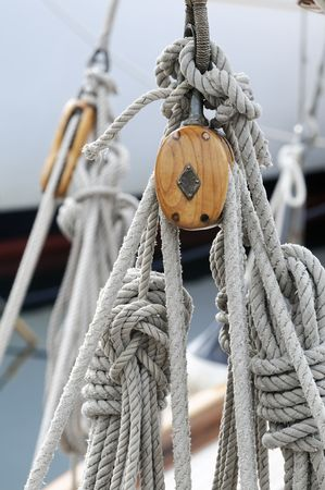 Detail of wooden blocks with ropes on a classical sailboat