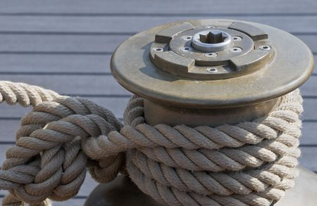 Rope tie up on a winch of a sailboat