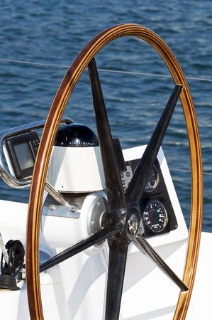 Detail of rudder, compass and nautical instruments of a sailing boat
