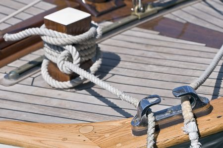 Close-up of a moored boat with bitt and ropes Stock Photo