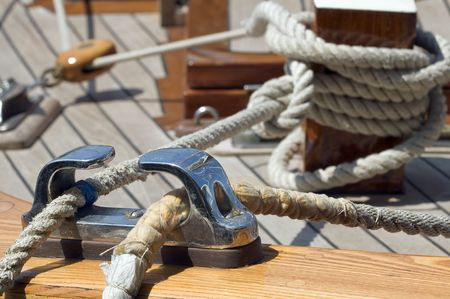 Close-up of ropes on a wooden sailboat