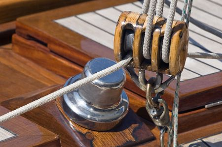 cordage: Close-up of sailing block of a wooden yacht