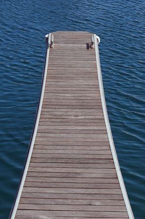Wooden jetty in a blue sea