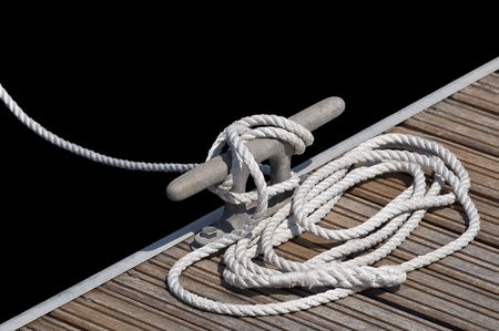 White rope tied up on a cleat