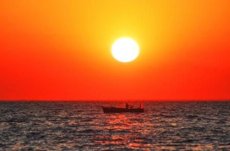 Fishboat at sunset