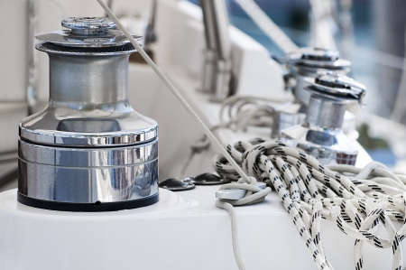 rigging: Winches and ropes on a sailboat deck Stock Photo