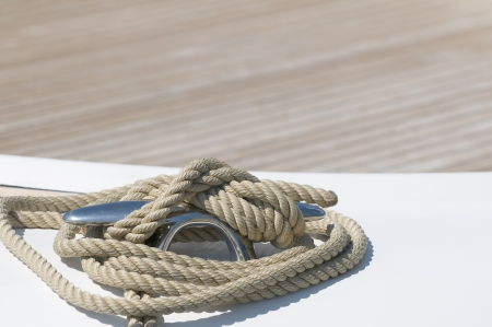 Close-up of rope tied-up on a boat bollard photo