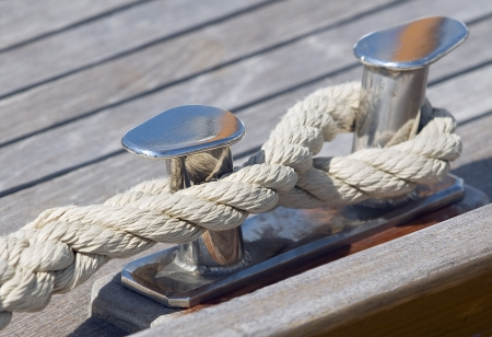 Boat rope tied up on a bitt photo