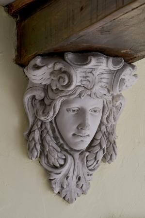 Detail of a frieze under a wooden beam Stock Photo