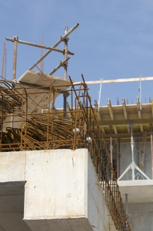 Detail of a building under construction with concrete, reinforcement and scaffold Stock Photo