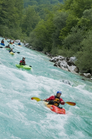 Line of kayakers on Soca river in Slovenia Editorial