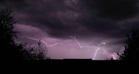 Lightning Storm and Skyline Silhouette Stock Photo - 4190380
