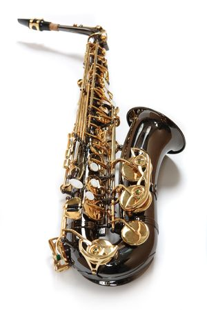 Saxophone of the colour of chocolate with gold. Musical Instrument.