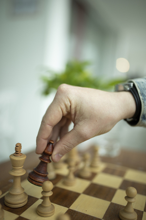 Man playing chess. Concept of business strategy and tactic