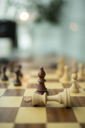Wooden chess pieces on a chessboard, leadership concept 스톡 콘텐츠