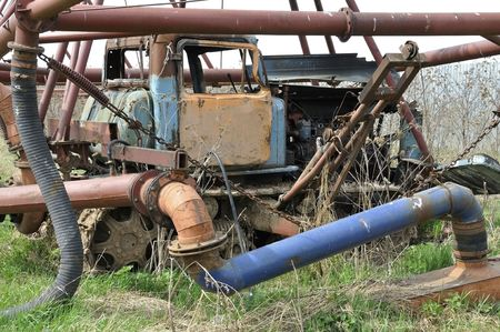 The big rusty sprinkling tractor photo