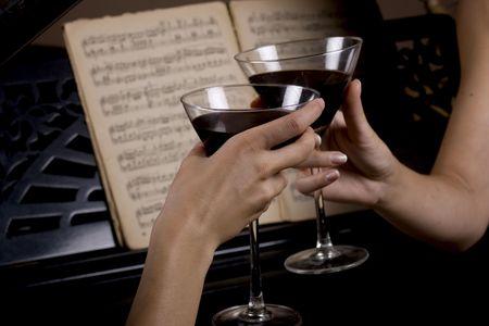 women sparkling two wine glasses Stock Photo
