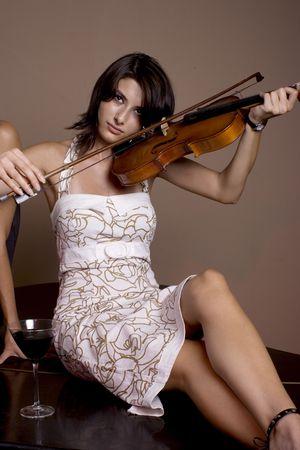 girl playing at a stradivarius violin