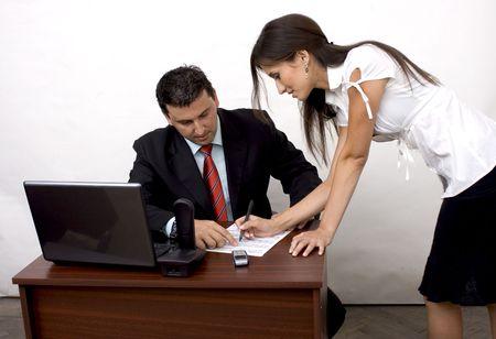 a beautiful secretary explaining something to her boss photo