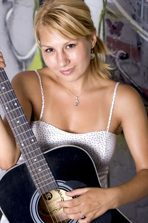 beautiful girl holding a guitar Stock Photo - 3567293