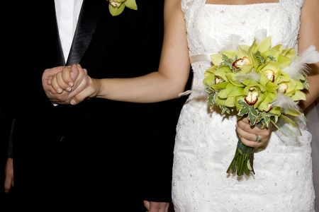 fidelity: couple join hands in marriage in church
