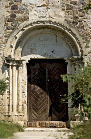 Ancient door of a medieval church photo