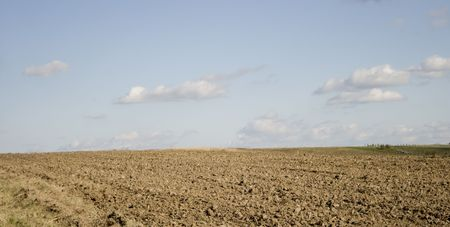 ploughed: Brown soil ploughed field in autumn