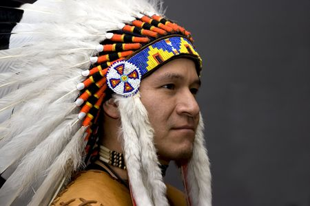 headdresses: Portrait of a native american in a studio