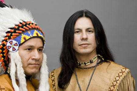 headdress: Portrait of two native americans in a studio