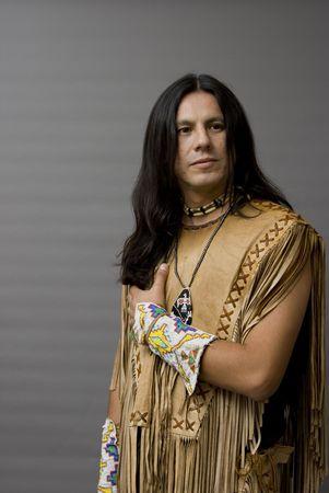 regalia: Portrait of a native american in a studio