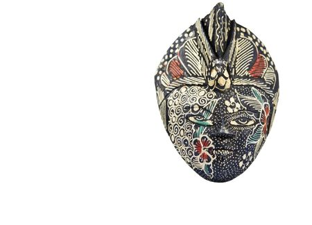 souvenirs: This mask is a hand carved wood Javanese mask. Beautifully painted and dyed using the ancient art of batik.