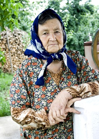 Portrait of a romanian old woman in the countryside