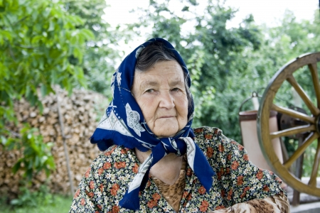 Portrait of a romanian old woman in the countryside photo