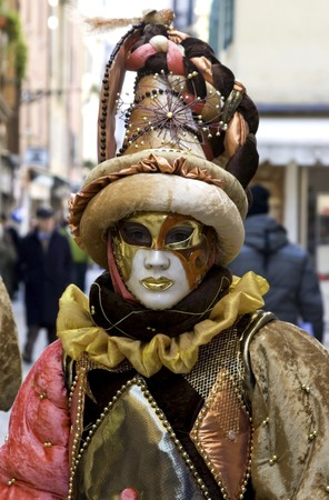 conceal: Woman in full decorative carnival costume in Venice.